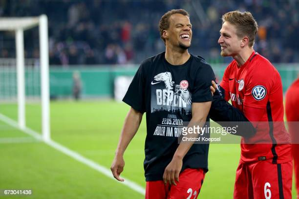 Tmothy Chandler and Bastian Oczipka of Frankfurt celebrate after winning the penalty shoot out during the DFB Cup semi final match between Borussia...