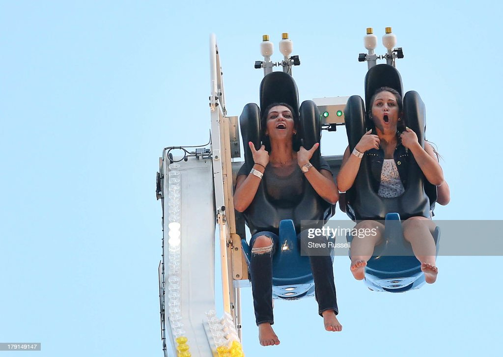 TORONTO, ON- AUGUST 31 - Tna Wakobenko and Staphanie Streubel ride the Mach 3 during the final weekend of the Canadian National Exhibition at CNE Grounds in Toronto, August 31, 2013.