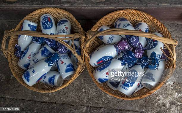 To attract more costumers local sellers try to design more fashionable containers for traditional rice wine such as the blueandwhite bottles placed...