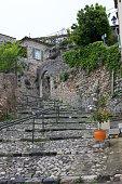 Cobblestone road climbing to  the village of Biot, Cote d'Azur