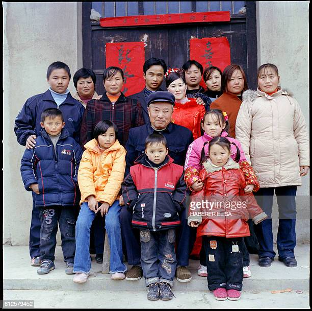 To celebrate his son's wedding Ding Zhifa's father a 70yearold farmer poses with his chidren and grandchildren Health problems keep him from working...