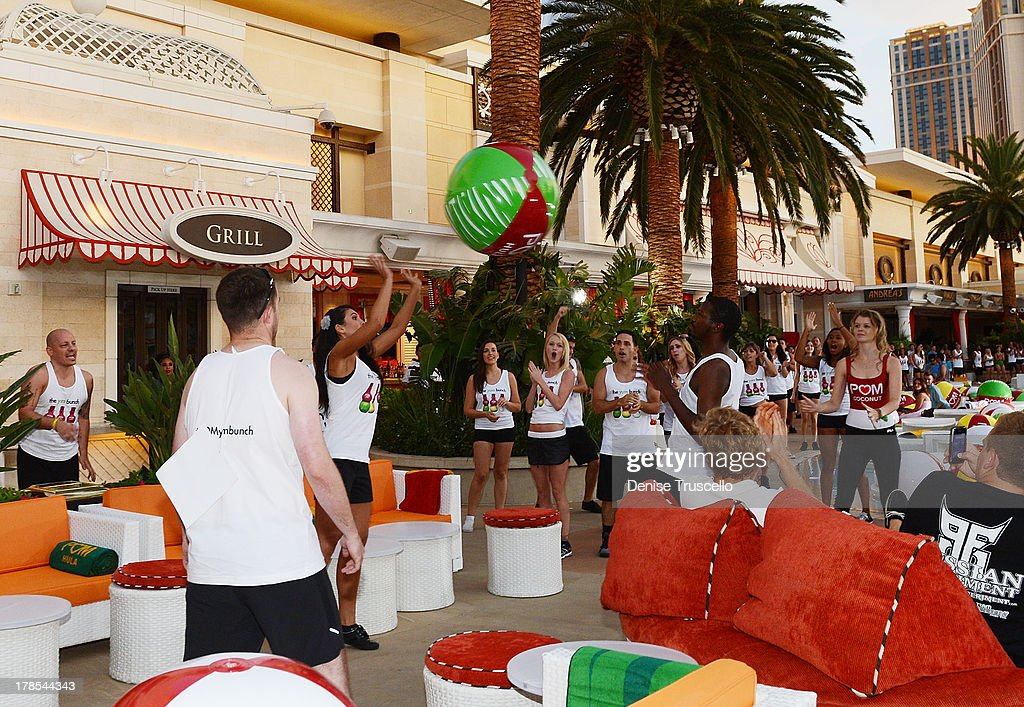 To celebrate POM Wonderful's launch of three new 100% Juice Blends, 125 people set the Guinness World Record for the longest beach-ball bounce in history, which was led by Cheryl Burke and Karina Smirnoff at the Encore Beach Club at Wynn Las Vegas on August 29, 2013 in Las Vegas.