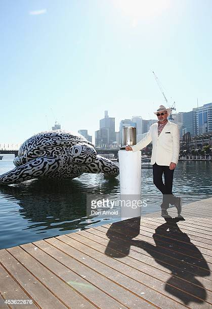 To celebrate the world's first Undersea Art Exhibition a 5 metre tall 15 metre long Sea Turtle arrives at Cockle Bay and poses alongside the artist...