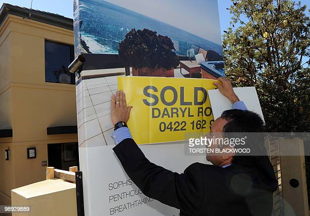 To go with a feature story Australiaproperty by Madeleine Coorey Eastern suburbs real estate agent Daryl Rosen puts a 'sold' sticker over the...