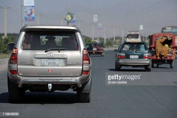 To go with AfghanistaneconomysocietyoffbeatFEATURE by Mustafa Kazemi In this photograph taken on June 20 a car with the number '39'on its license...