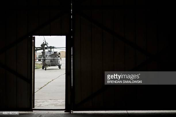To go with 'AfghanistanUnrestUSNatoMilitaryMedicine' by Dan De Luce In this photograph taken on May 31 a Blackhawk helicopter with the US 159 Combat...