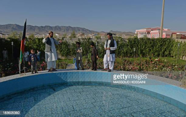 To go with AFP Story AfghanistanunrestlifestyleconstructionFEATURE by Ben Sheppard In this picture taken on September 26 Afghan men and children...