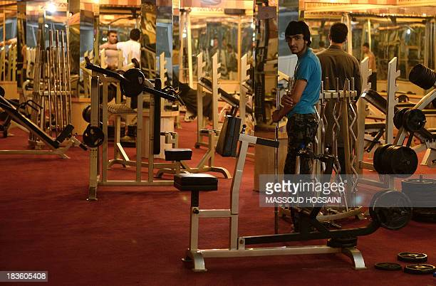 To go with AFP Story AfghanistanunrestlifestyleconstructionFEATURE by Ben Sheppard In this picture taken on September 24 Afghan men excercise at a...