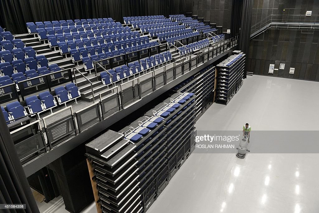 To go with AFP story Entertainment-Malaysia-Britain-film-company-Pinewood,FEATURE by Bhavan Jaipragas In a picture taken on June 25, 2014, a worker cleans the floor of the television studio Pinewood Iskandar Malaysia Studios in Nusajaya, Malaysia. A Marco Polo-era replica ship floats in a massive water tank while just metres away ancient Mongol tents recreate the court of Kublai Khan -- welcome to Pinewood Studios' Asia production facility.