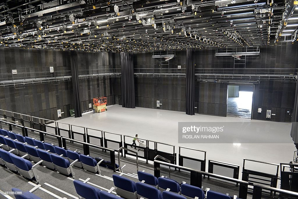 To go with AFP story Entertainment-Malaysia-Britain-film-company-Pinewood,FEATURE by Bhavan Jaipragas In a picture taken on June 25, 2014, a worker cleans the floor of the television studio Pinewood Iskandar Malaysia Studios in Nusajaya, Malaysia. A Marco Polo-era replica ship floats in a massive water tank while just metres away ancient Mongol tents recreate the court of Kublai Khan -- welcome to Pinewood Studios' Asia production facility. AFP PHOTO / ROSLAN RAHMAN