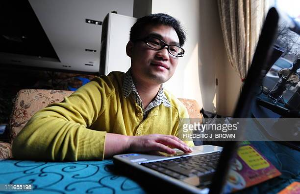 LIFESTYLECHINAVALENTINEINTERNETBeijing office worker Jiang Hui surfs the internet looking for love at a cafe in Beijing on February 5 2010 By joing...