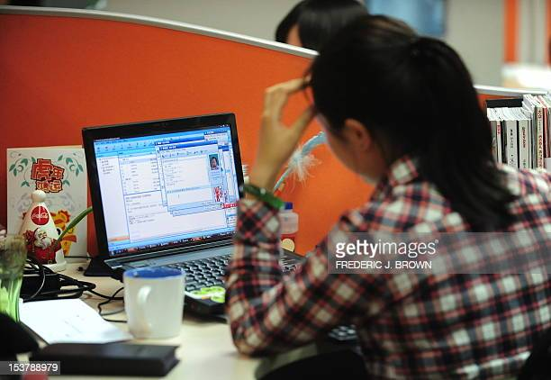 LIFESTYLECHINAUSITINTERNETGOOGLE A woman works online in her cubicle at an office in Beijing on February 4 2010 China's homegrown social media sites...