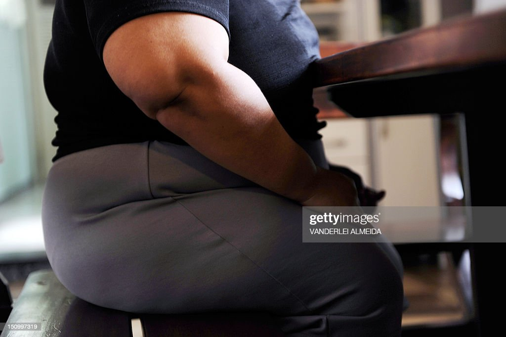To GO WITH AFP STORY by JAVIER TOVAR - Solange de Goncalves, 38, speaks with AFP at her house in Sao Goncalo, Niteroi, 35km north of Rio de Janeiro, Brazil on August 28, 2012. Solange dropped from 138 kilograms of weight to 123 kilograms in 50 days, after an operation to reduce the size of her stomach from 1,2 liters to 30 mililiters of capacity.