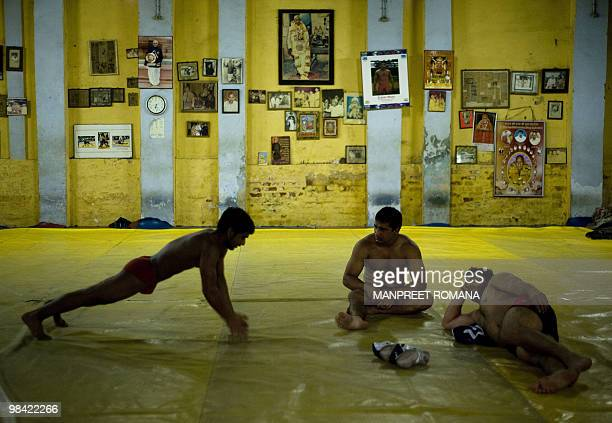 WRESTLINGINDCGAMES2010 An Indian wrestler exercises during a training session at Guru Hanuman Akhara in New Delhi on April 7 2010 Far from the hype...