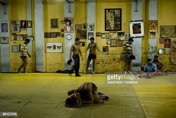 WRESTLINGINDCGAMES2010 Indian wrestlers practice during a training session at the Guru Hanuman Akhara in New Delhi on April 8 2010 Far from the hype...