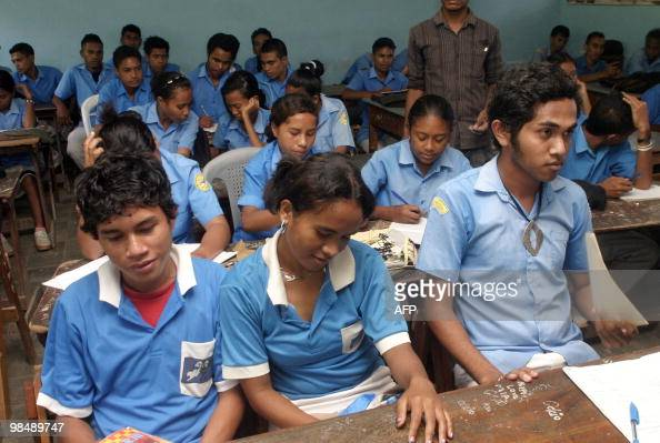 TIMORWOMENEDUCATIONYOUTHFAMILY Children sit in a classrom in Dili on March 25 2010 The population of East Timor is heavily slanted towards its youth...