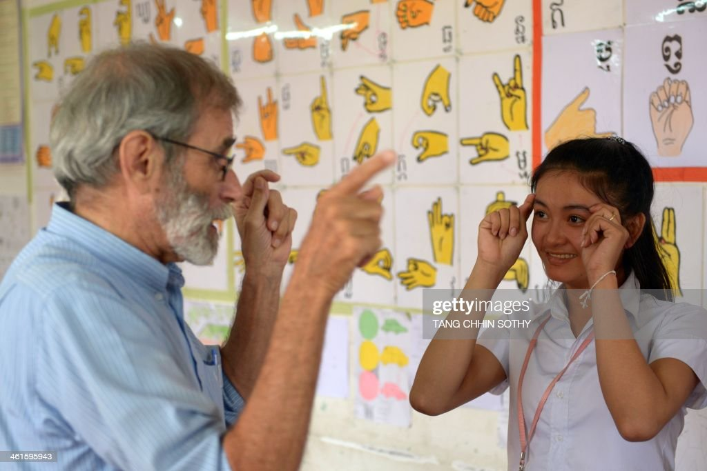 To go with AFP Story CambodiadeafeducationhealthdisabledFEATURE by Suy Se and Delphine Thouvenot This photo taken on October 15 2013 shows US priest...