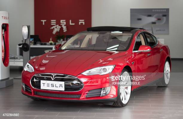 To go with AFP story ChinaautoshowenvironmentTeslaFOCUS by Bill Savadove This picture taken on March 17 2015 shows a Tesla Model S car on display at...