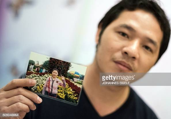 To go with AFP story ChinapoliticseconomysociallabourFOCUS by BEN This picture taken on January 10 2016 shows Wu Rongpu holding a picture of his wife...