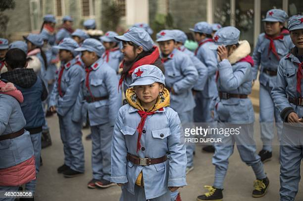 To go with AFP story ChinapoliticseducationhistoryFEATURE by Tom Hancock In this picture taken on January 21 children dressed in uniform wait to...