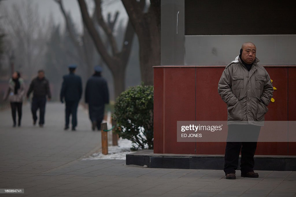 To go with AFP story 'China-population-labour-economy-social,FOCUS' by Fran wang An elderly man stands in Jinshan park in Beijing on January 30, 2012. China's demographic timebomb is ticking significantly louder with the first fall in its labour pool for decades, analysts say, highlighting the risk that the country grows old before it grows rich. AFP PHOTO / Ed Jones