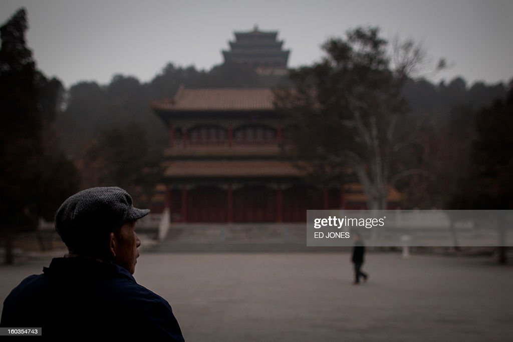 To go with AFP story 'China-population-labour-economy-social,FOCUS' by Fran wang An elderly man stands at the entrance to Jinshan park in Beijing on January 30, 2012. China's demographic timebomb is ticking significantly louder with the first fall in its labour pool for decades, analysts say, highlighting the risk that the country grows old before it grows rich. AFP PHOTO / Ed Jones