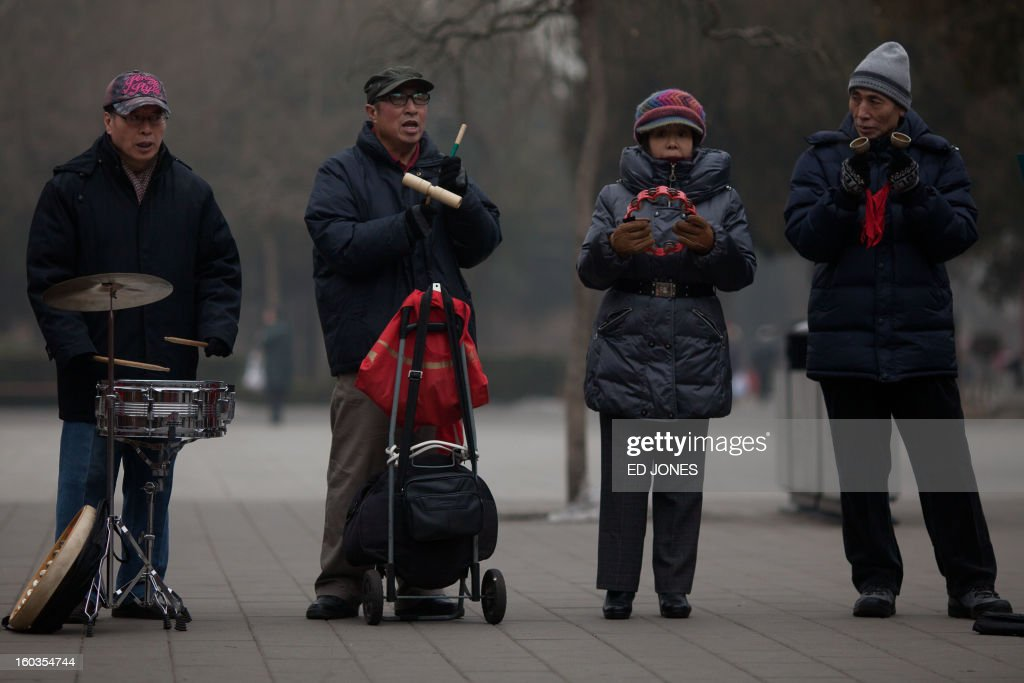 To go with AFP story 'China-population-labour-economy-social,FOCUS' by Fran wang Elderly people play music together in Jinshan park in Beijing on January 30, 2012. China's demographic timebomb is ticking significantly louder with the first fall in its labour pool for decades, analysts say, highlighting the risk that the country grows old before it grows rich. AFP PHOTO / Ed Jones