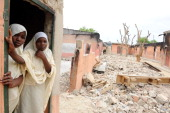 Fear pervades Nigerian city at heart of Islamist insurgency by MJ Smith Female student stands in a burnt classroom at Maiduguri Experimental School a...