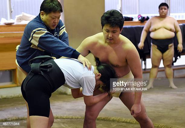 To go with AFP story JapanSocialWomenSumo Feature by Jessica Glanz In a photograph taken on January 25 Nihon University sumo club coach Hideto...