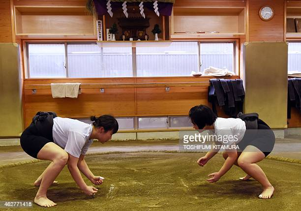 To go with AFP story JapanSocialWomenSumo Feature by Jessica Glanz In a photograph taken on January 25 female sumo wrestler Sayaka Matsuo fights with...