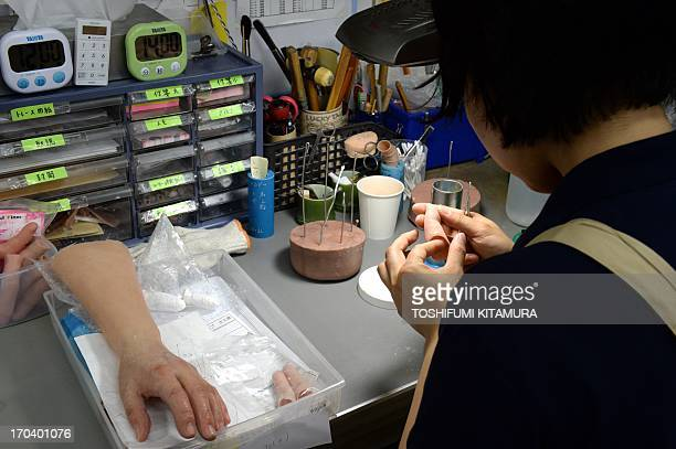 To go with AFP story 'Japansocietycrimeyakuza' Feature by Harumi Ozawa In this picture taken on on May 27 a prosthetics technician prepares a...