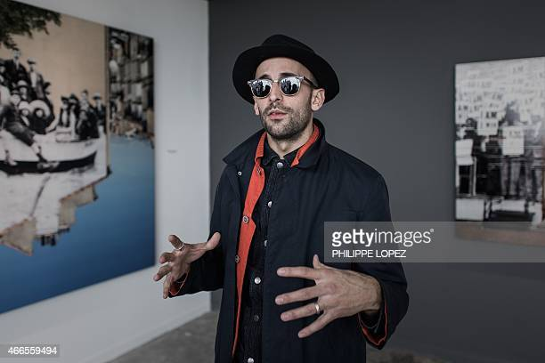 To go with AFP story 'LifestyleHong KongFranceartJRINTERVIEW' by Aaron TAM This picture taken on March 13 2015 shows French street artist JR during...