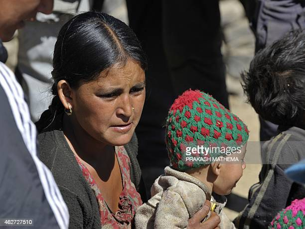 To go with AFP story NepalchildrensocialmarriageFEATURE by Ammu KANNAMPILLY In this photograph taken on November 5 Nepalese resident Dana Sunar who...
