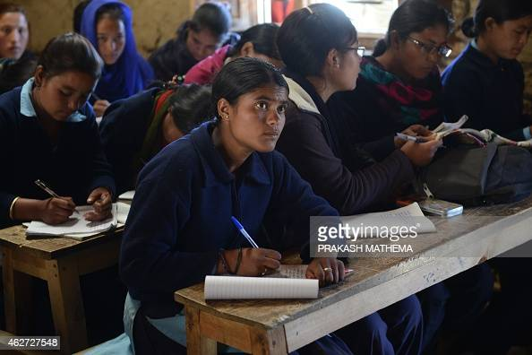 To go with AFP story NepalchildrensocialmarriageFEATURE by Ammu KANNAMPILLY In this photograph taken on November 6 Nepalese schoolgirl Susmita Kami...