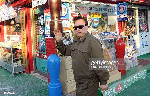 NKoreapoliticsentertainmentoffbeatINTERVIEW by Daneil Rook South Korean Kim YoungShik a lookalike of North Korean Leader Kim JongIl waves in front of...