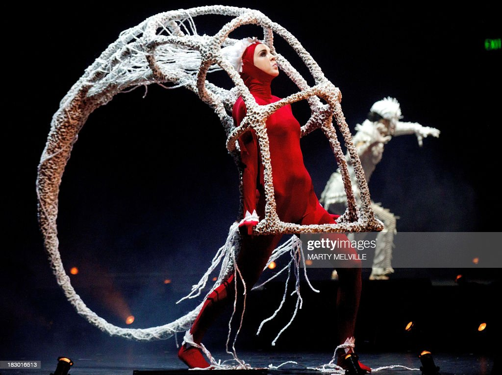 To go with AFP Story NZealand-fashion,FEATURE by Neil Sands In a picture taken on October 1, 2013, a model presents a creation titled 'Void' by New Zealand's AmJo Drysdale and Sebastian Denize during the World of Wearable Arts show in Wellington. Fashionistas at first scoffed at Suzie Moncrieff's displays of bizarre bras and out-there attire, but 25 years on international designers are clamouring to be part of Wellington's annual World of WearableArt show. AFP PHOTO / MARTY MELVILLE