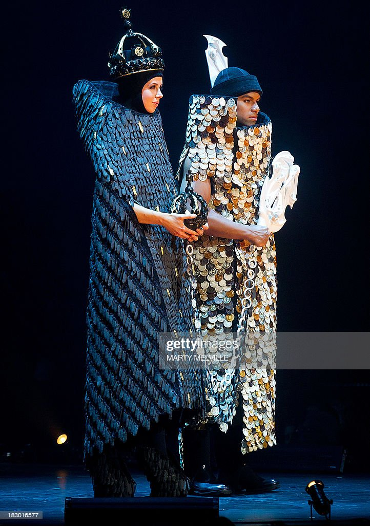 To go with AFP Story NZealand-fashion,FEATURE by Neil Sands In a picture taken on October 1, 2013, models present the Supreme Wow winner titled 'The Exchange' by New Zealand's Natasha and Tatyanna Meharry during the World of Wearable Arts show in Wellington. Fashionistas at first scoffed at Suzie Moncrieff's displays of bizarre bras and out-there attire, but 25 years on international designers are clamouring to be part of Wellington's annual World of WearableArt show. AFP PHOTO / MARTY MELVILLE