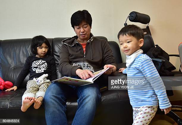To go with AFP story 'SKoreapopulationbirthfamilygender' FEATURE by Jung HaWon This picture taken on December 22 2015 shows South Korean father Kim...