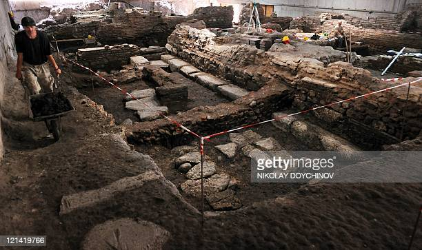 ''Sofia digs up its Roman ancestor city to attract tourists' by Diana Simeonova A worker pushes a wheelbarrow during an archaeological excavations in...
