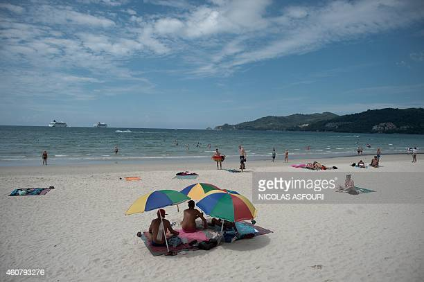 To go with AFP story THAILANDASIATSUNAMIANNIVERSARY by Preeti Jha and Thanaporn Promyamyai In this picture taken on December 1 people relax on Patong...
