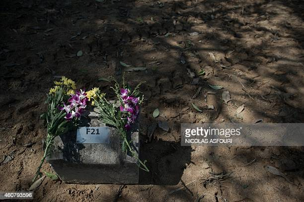 To go with AFP story THAILANDASIATSUNAMIANNIVERSARY by Preeti Jha and Thanaporn Promyamyai This picture taken on December 4 2014 shows flowers from...