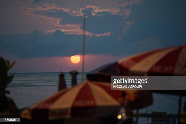 To go with AFP Story ThailandlifestyletourismcrimeFEATURE by Daniel Rook This picture taken on February 14 2013 shows the sunset over Patong beach in...