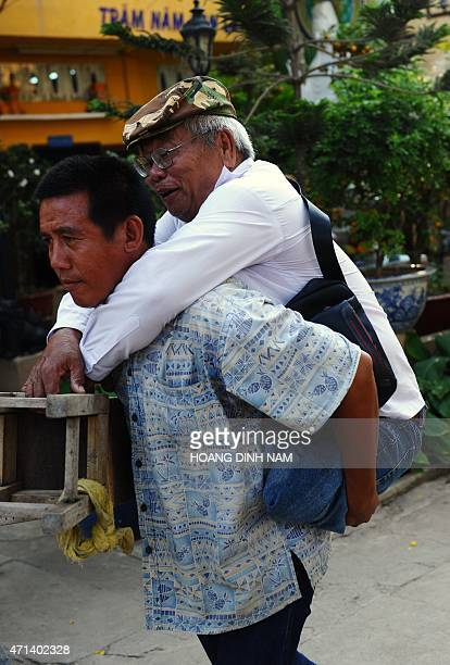 To go with AFP story Vietnamwarhistorypoliticsanniversary ADVANCER by Cat Barton This picture taken on April 9 2015 shows Nguyen Van Quang a disabled...