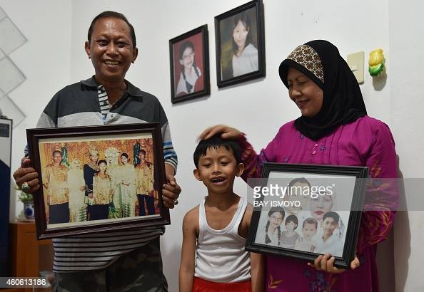 To go with AsiatsunamianniversaryIndonesiafamiliesFEATURE by Arlina Arshad In this picture taken on November 28 Rusli Abdul Rahman and his wife...