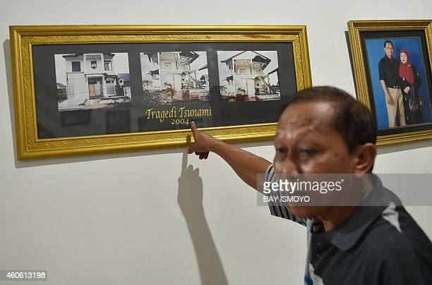 To go with AsiatsunamianniversaryIndonesiafamiliesFEATURE by Arlina Arshad In this picture taken on November 28 Rusli Abdul Rahman shows his house in...
