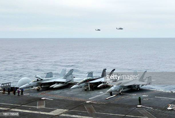 To go with 'AsiaUSmilitarydiplomacyINTERVIEW' by Martin Abbugao This photograph taken on October 24 2013 in the South China Sea shows US fighter jets...