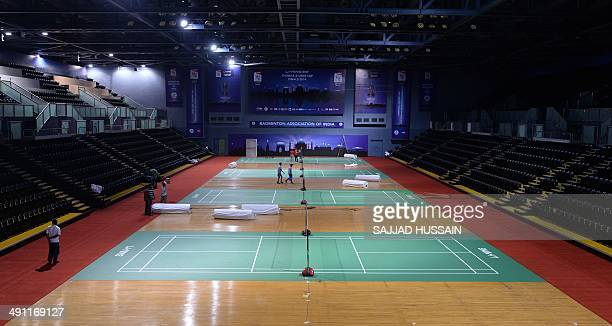 To go with 'BadmintonSuper Dan to light up China's record bid' PREVIEW by Kuldip Lal Officials adjust equipment on badminton courts at The Siri Fort...