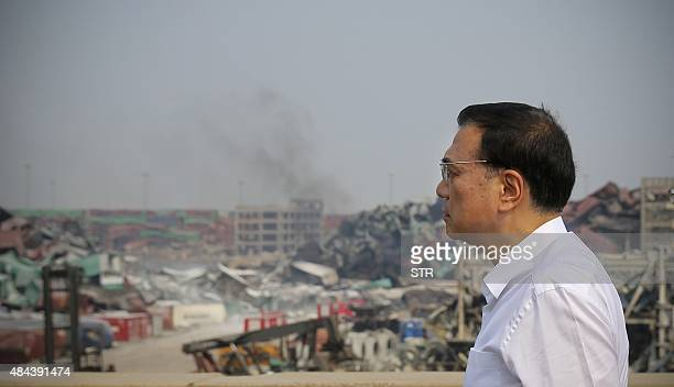 To go with China explosion Tianjin politicsFOCUS by Benjamin Haas This photo taken on August 16 2015 shows Chinese premier Li Keqiang inspecting the...