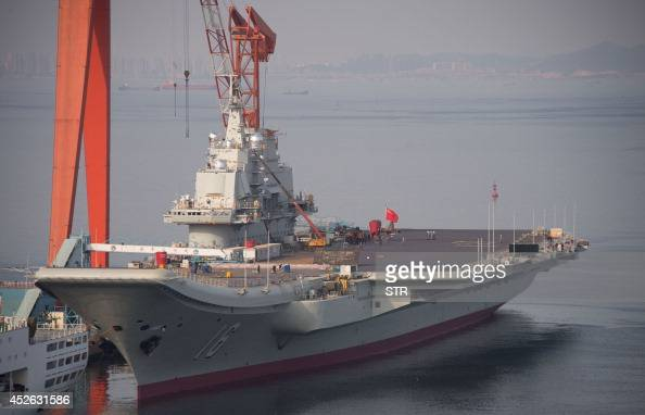 To go with ChinaJapanUSmaritimedefenceFOCUS by Sebastien Blanc This photo taken on July 6 2014 shows the Chinese aircraft carrier Liaoning docked at...