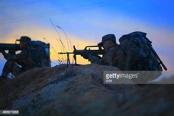 To go with ChinaJapanUSmilitaryFOCUS This picture taken on April 9 2014 shows soldiers taking part in an exercise in Heihe northeast China's...